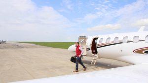 Winner Aviation a man stepping off of a plane